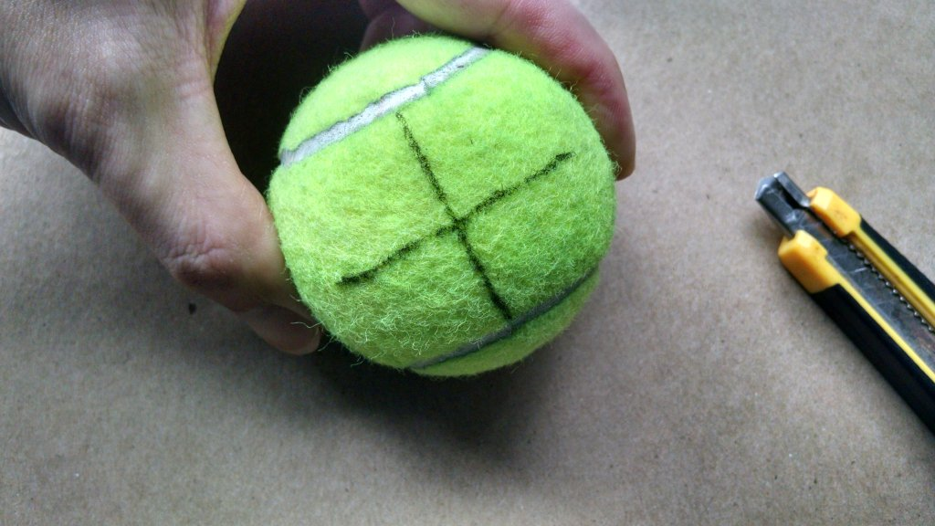 Holding Tennis Ball for Cutting